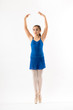 Graceful young ballerina posing on pointe