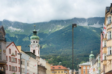 INNSBRUCK, AUSTRIA - June 27, 2018: Street view of downtown in Innsbruck, Austria.view of Buildings around Innsbruck, Austria © ilolab