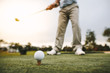 Golfer taking a shot at golf course driving range