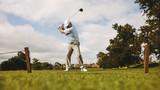 Senior male golfer taking shot - 242165927