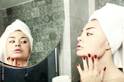 Leinwanddruck Bild Woman in towel and body care