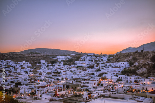 LINDOS,RHODES/GREECE OCTOBER 18 2018 : Lindos village at sunset panorama photo taken from castle