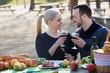 Leinwanddruck Bild - Couple having picnic at countryside
