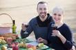 Leinwanddruck Bild - adults drinking wine at table