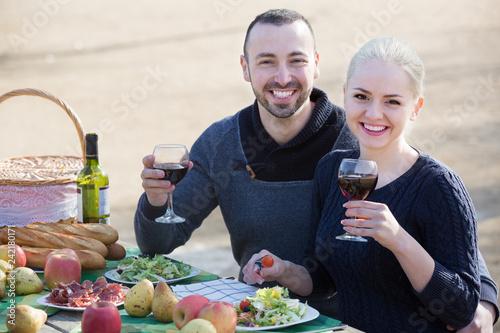 Leinwanddruck Bild adults drinking wine at table