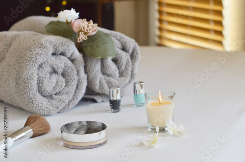 spa setting with towels and candles