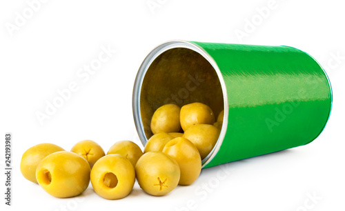 Green olives spilled from a tin can close-up on a white background.