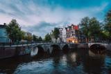 Bridge over Keizersgracht Emperor's canal in Amsterdam, dutch scene at twilight, Netherlands - 242194960