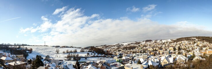 Panoramic view on Czech spa and ski village Luhachovice with mountains and hills with snow ski places for the turists and travellers © Sergii