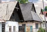 Traditional eastern europe rural architecture in countryside. Rural scene of old houses in village.