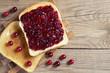 Leinwandbild Motiv Two slices of toasted bread with cranberry jam