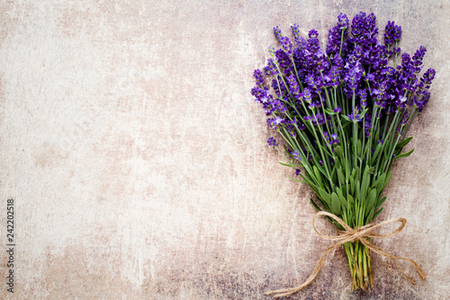 Lavender flowers, bouquet on rustic background, overhead. - 242202518