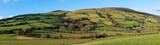 Beautiful landscape panorama of fields, farms, and hills in the Irish countryside - Glenariff, County Antrim, Northern Ireland