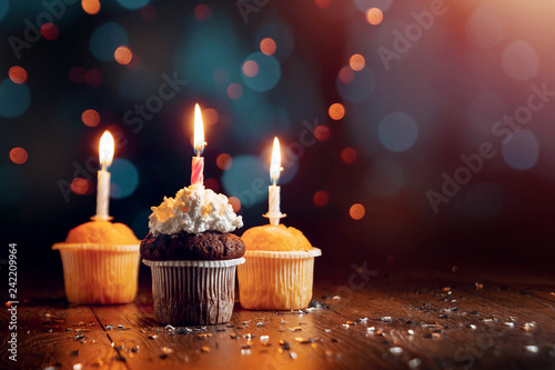 Creative background, cupcake with candles, beautiful bokeh. Happy Birthday. Present. Concept for Holiday Card, Flyer, Background. Copy space - 242209964