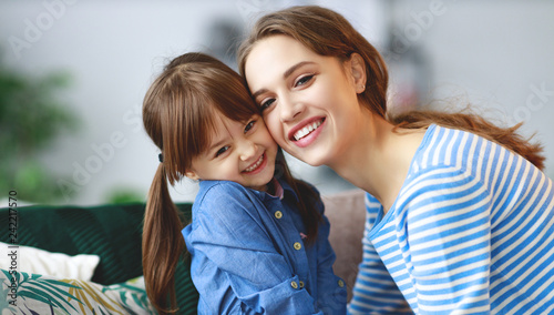 happy loving family mother and child daughter hugging at home. - 242217570