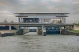 Passenger boat passing through canal locks near Amsterdam, Holland - 242233529