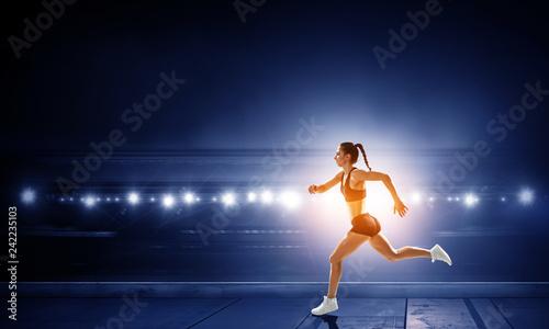 Foto Murales Sportswoman run race. Mixed media
