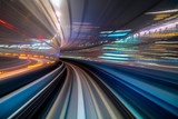 Motion blur of a city and tunnel from inside a moving monorail in Tokyo - 242235357