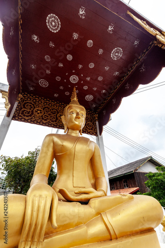 Golden Buddha statue close up, tradition and religion in Southeast Asia, travel concept