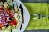 Greek salad with fresh vegetables, feta cheese and black olives - 242256561