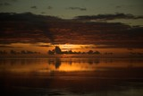 Beautiful sunset reflected in the ocean at a tropical island - 242259391