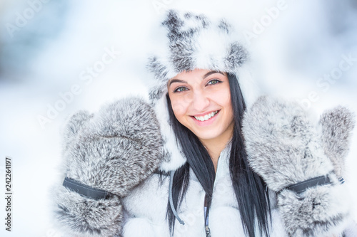 Winter portrait of attractive young woman in warm clothing from polar fox