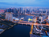 Aerial view of Downtown Singapore city in Marina Bay area. Financial district and skyscraper buildings at night - 242279769