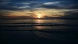 Small waves under a clear sky at sunset. Alghero, Sardinia - 242294924