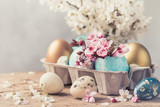 Easter eggs and spring flowers on rustic wooden background.Easter holiday card copy space. - 242297967