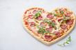 Heart shaped pizza with pepperoni. Valentines day romantic menu