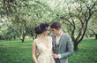 Lovely couple in love standing in the park outdoors