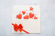 Red heart shaped cookies fly out of envelope.