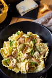 Reginette noodles in cream sauce with fresh chanterelles and capers - 242324110