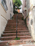 Fototapeta Na drzwi - Ancient stone staircase, detail of architecture in the city, up and down © Fercan