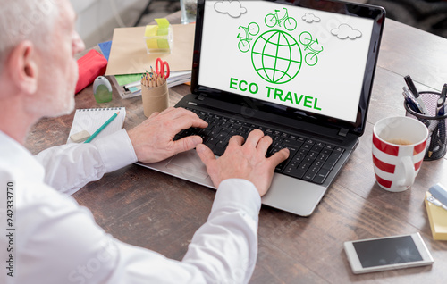 Foto Murales Eco travel concept on a laptop screen