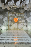 Wooden arch and chairs at wedding ceremony with words all you need is love - 242334364