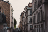 Narrow street and tall buildings in Montmartre - 242336399