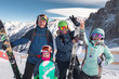 Leinwanddruck Bild - Happy family skiing at the mountains. Kids in ski school.