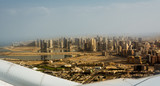 Dubai's buildings seen from the airplane taking off