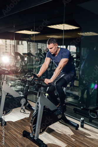 Foto Murales Portrait Of A Physically Fit Man In Modern Fitness Center