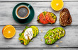 breakfast with avocado, sesame, orange, egg, coffee on a wooden background - 242348996