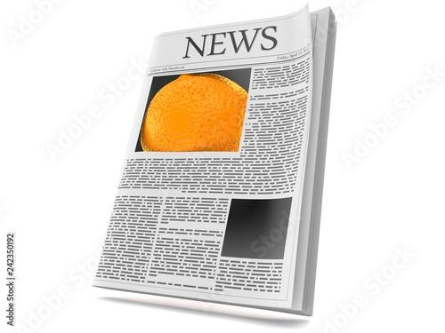 Orange inside newspaper