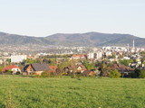 Quite cityscape landscape of european Bielsko-Biala city and countryside, green grassy meadow at Beskids in POLAND