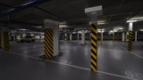 Rotating shot of almost empty underground parking garage with just two cars there - 242376543