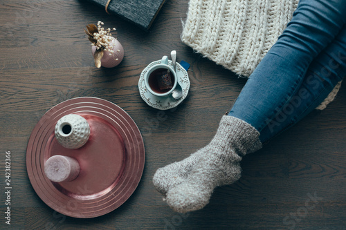 Still life details, cup of tea, book
