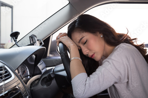 Fridge magnet Tired young woman sleep in car, Hard work causes poor health, Sit asleep while the car is on a red light, Traffic jam or overworked concept