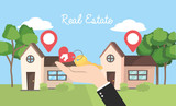 real state houses with location and businessman with key - 242413133