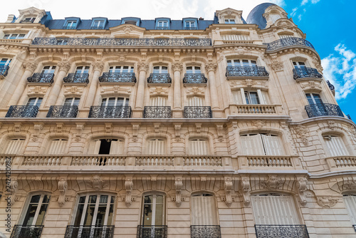 Paris, beautiful building in winter, typical parisian facade in the Marais, view from the square du Temple