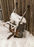 Wheelbarrow at a construction site in the snow in winter - 242425167