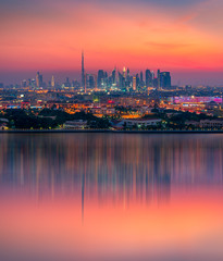 Beautiful skyline of Dubai city at night in United Arab Emirates © Evgeni